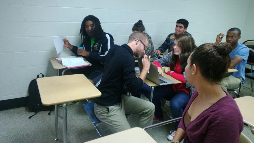 Freshman William McDonald (middle left) looks back at freshman Danielle Berry (middle).