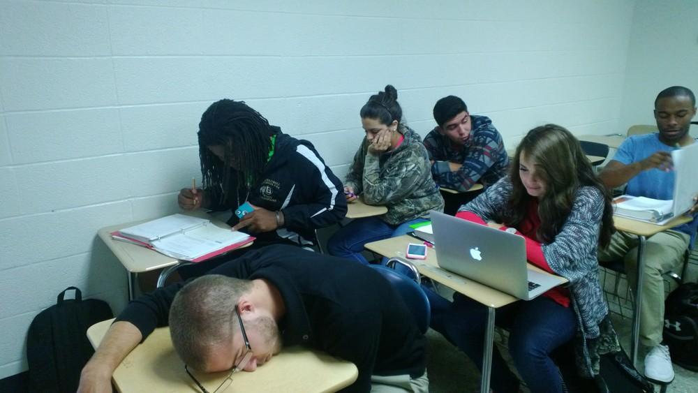 Freshman William McDonald (bottom left) sleeps during class.