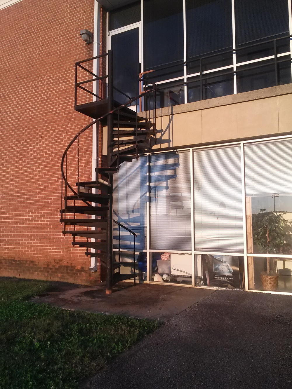 On the back side of the Foster Education building there are spiral stairs that lead all the way up to the second floor. Shortcut!
