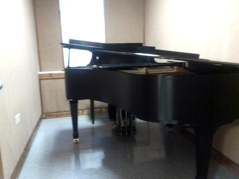 In the music department there are practice rooms where anyone is welcome to play music on the pianos there.