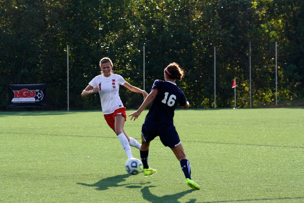 #1, Lindsay Tuten, confidently charges toward the ball.