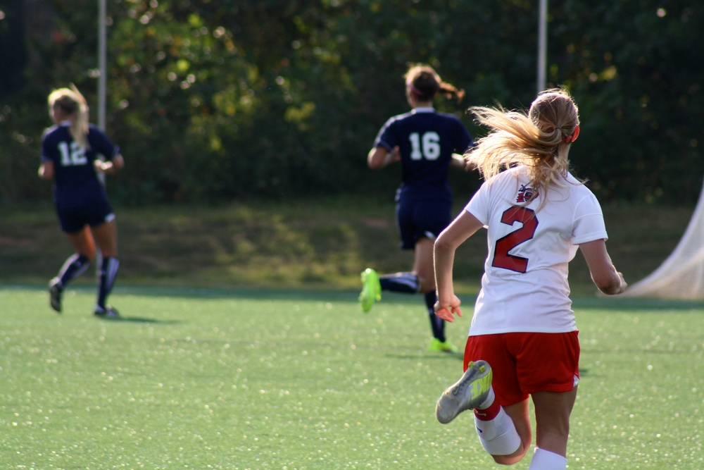 #2, Olivia Schmike, running towards her opponents.
