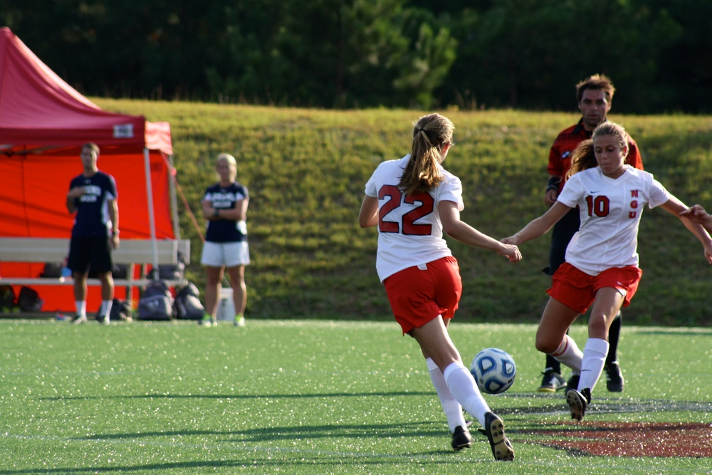 #22, Kathryn Allen, makes an attempt to get the ball.