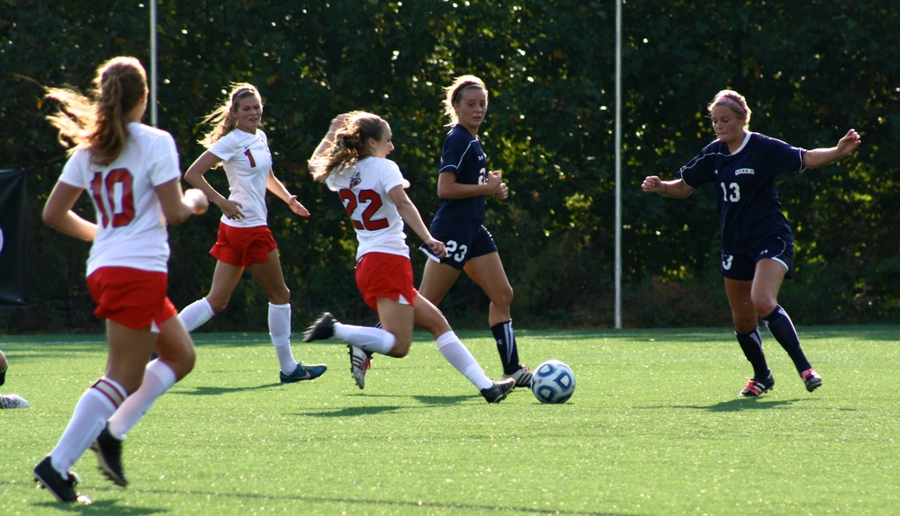 #22, Kathryn Allen, makes a successful attempt to kick the ball.