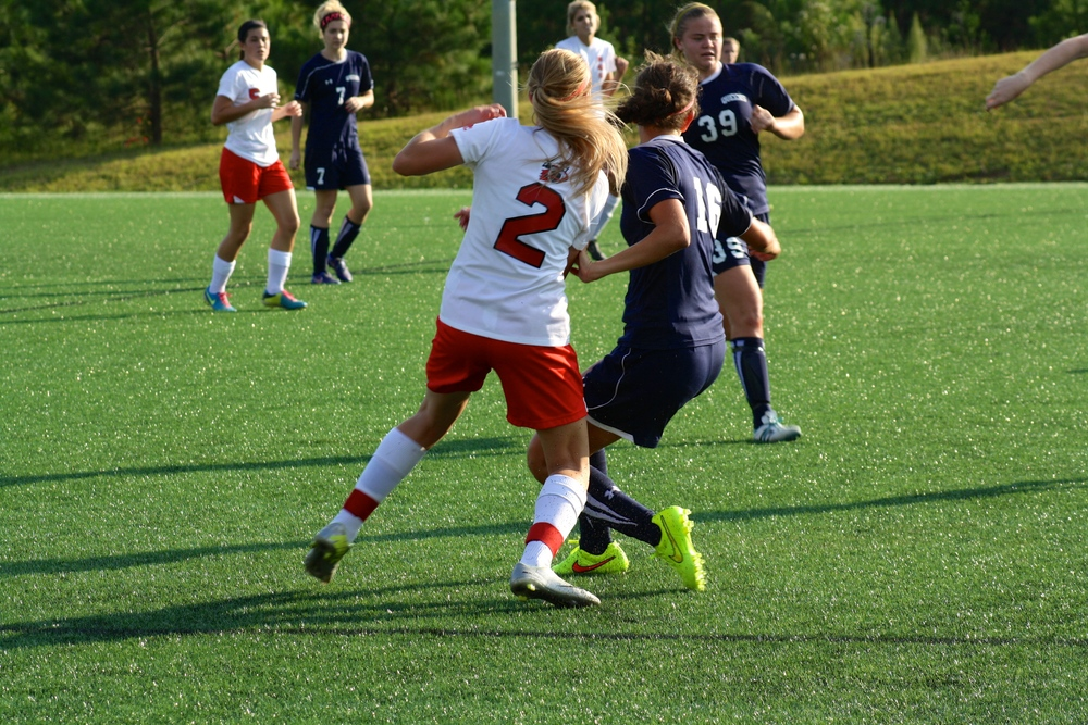 #2, Olivia Schmike, clashes with an opponent.