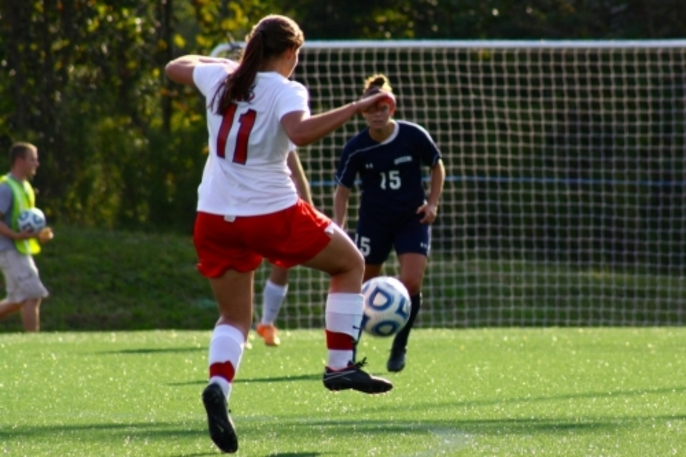 #11, Lauren Prevett, sends the ball flying.
