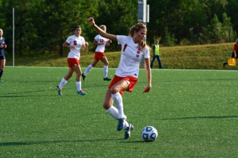 #1, Lindsay Tuten, kicks the ball.