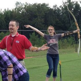 Photo Credit: Lauren Gravely  Jonathan Rentz, instructor, admits Tiffany is better at archery than he expected.