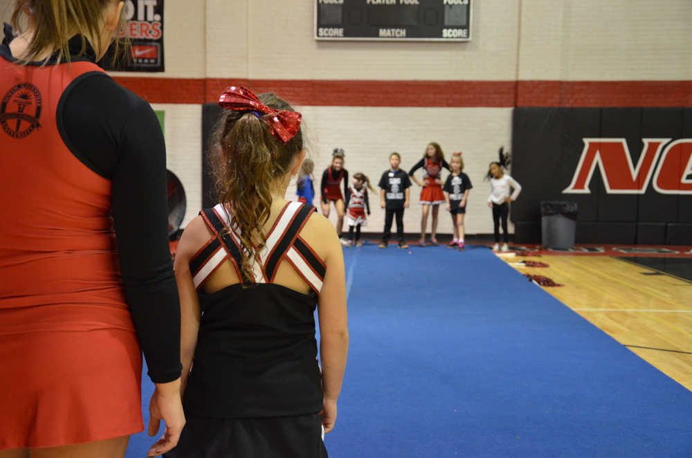 A game of Red Light, Green Light is about to break out at the NGU cheer camp October 4.
