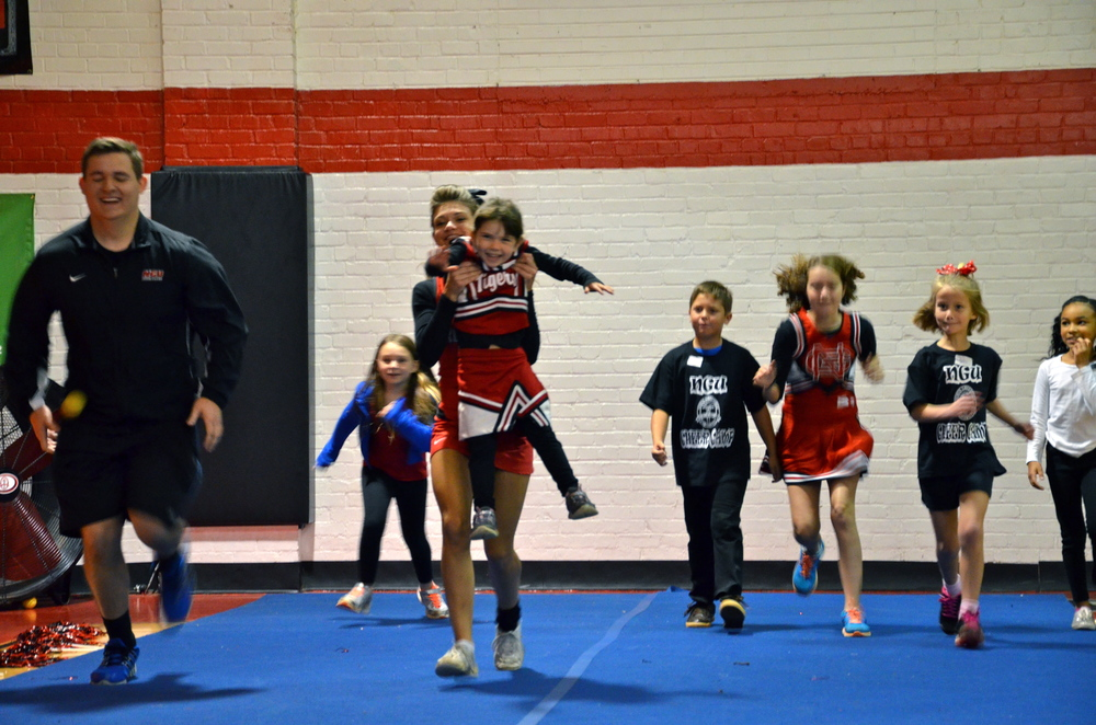 A mini-Crusader is getting a little help to the finish line at the cheer camp October 4.