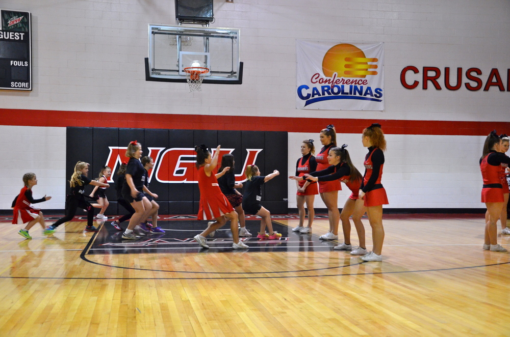 """The players come to a sudden halt as """"Red Light!"""" is shouted during cheer camp held on the NGU campus October 4."""