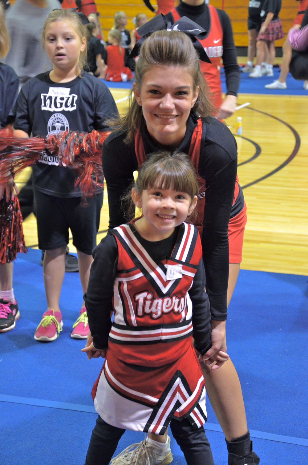 Cheerleading buddies pose for the camera before getting to work at the NGU cheer camp October 4.