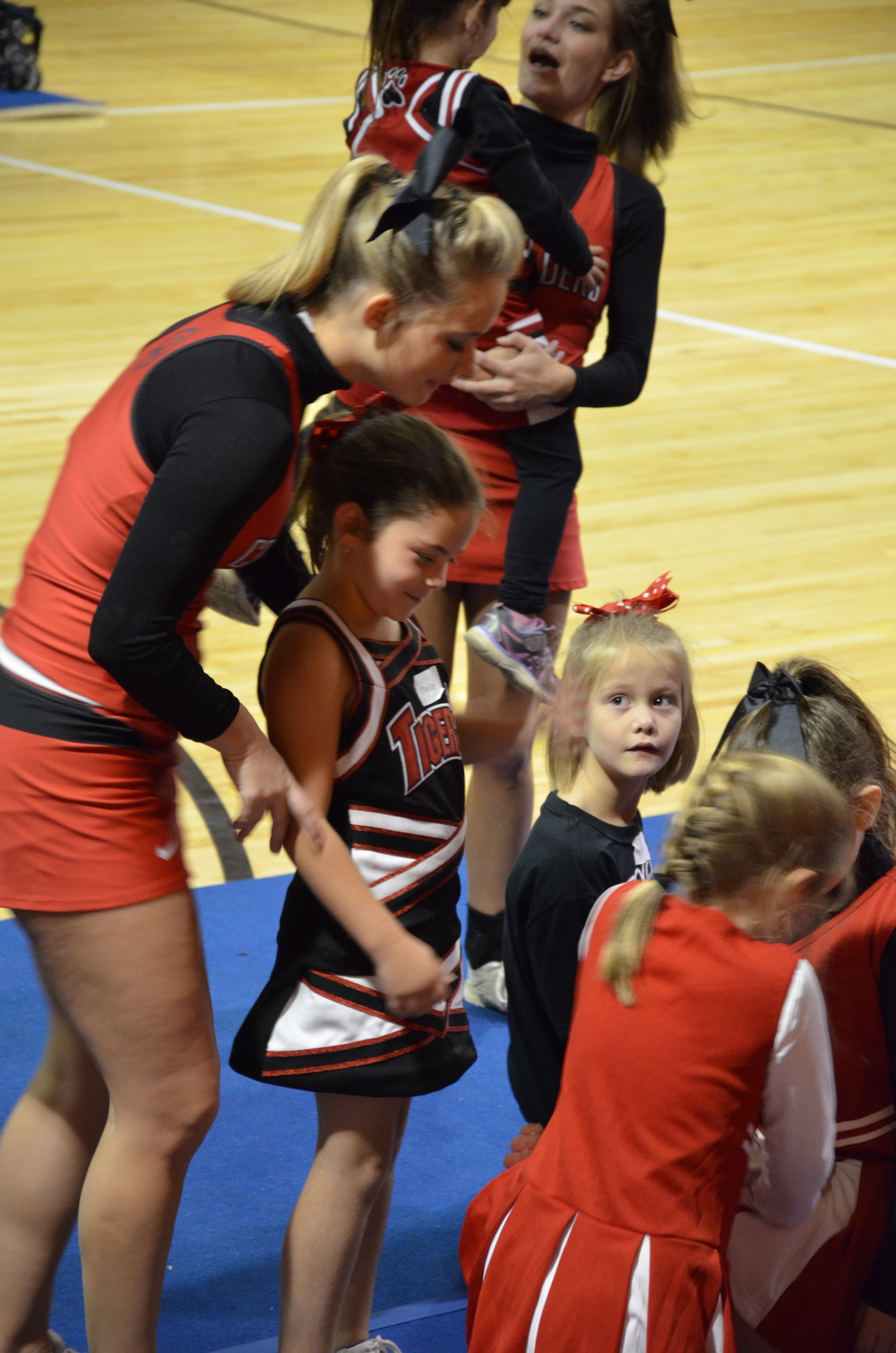 This little girl is ready to be lifted into the air by an NGU cheerleader.