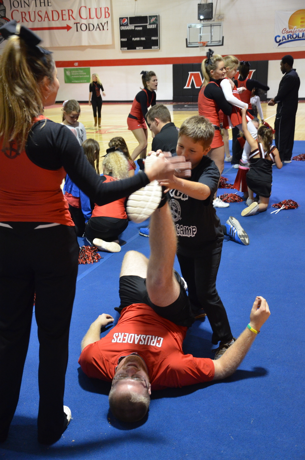 A big man needs a little help when it comes to stretching at NGU's cheer camp last weekend.