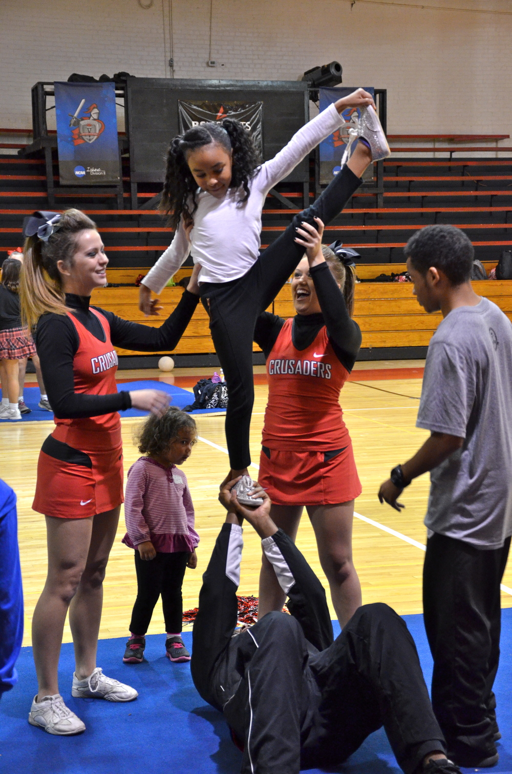 This mini-Crusader is going above and beyond to show off her skills at Crusader Cheer Camp last weekend.