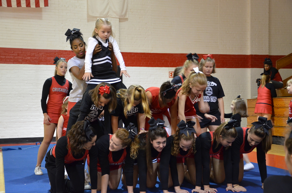 A lot of help is needed to get everyone in place for this big pyramid.