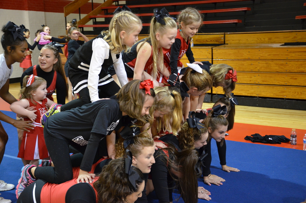 The team works together as they climb to form a good-looking pyramid.
