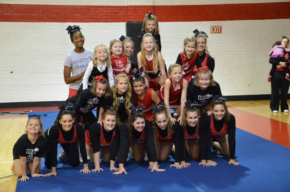 The final product consists of mini-Crusaders and NGU Cheerleaders at cheer camp last weekend.