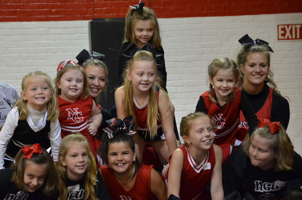 The mini-cheerleaders show off their balancing techniques.