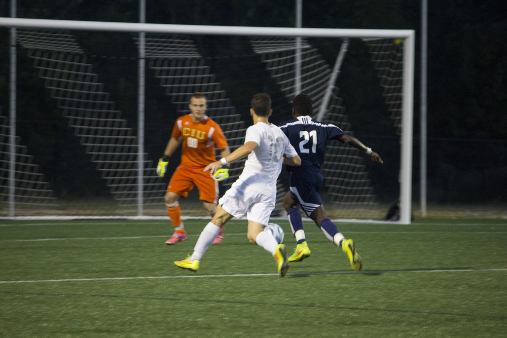 Thales Wieczorek, junior, sprints upfield to take a shot on goal.