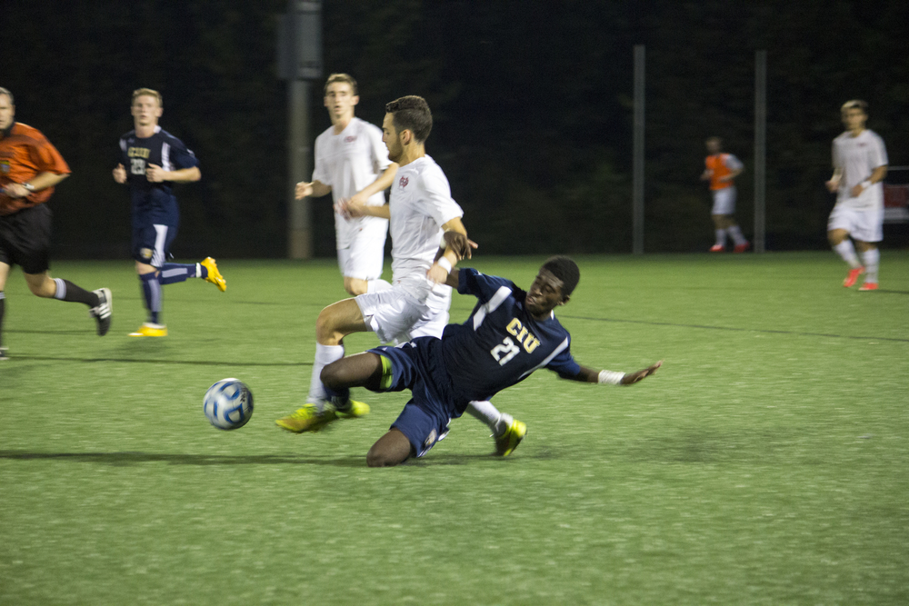 Thales Wieczorek, junior, bodies up against player #21 to get possession of the ball