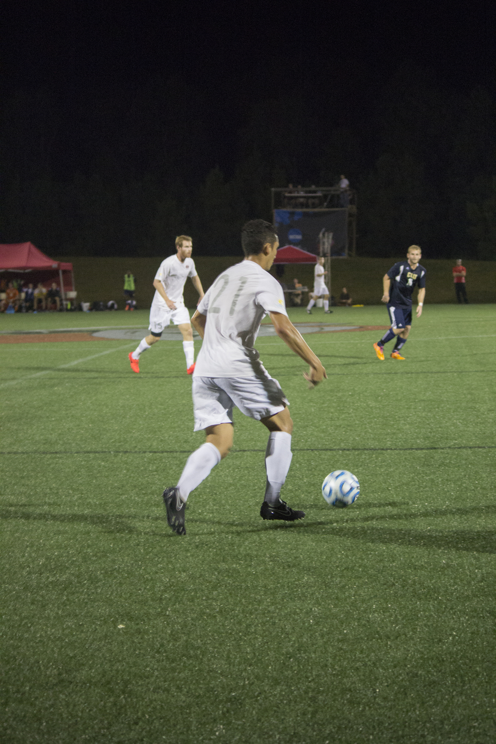 Senior Jonathan Arango dribbles the ball downfield.