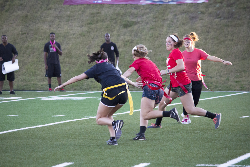 Senior Sarah Armstrong runs down the field trying to block her flag being pulled.