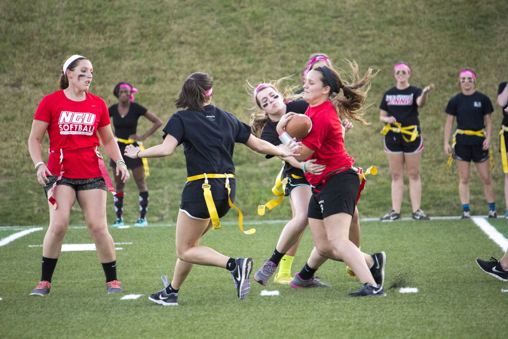 Senior Cassi Carpenter attempts to run past the onslaught of juniors trying to pull her flag
