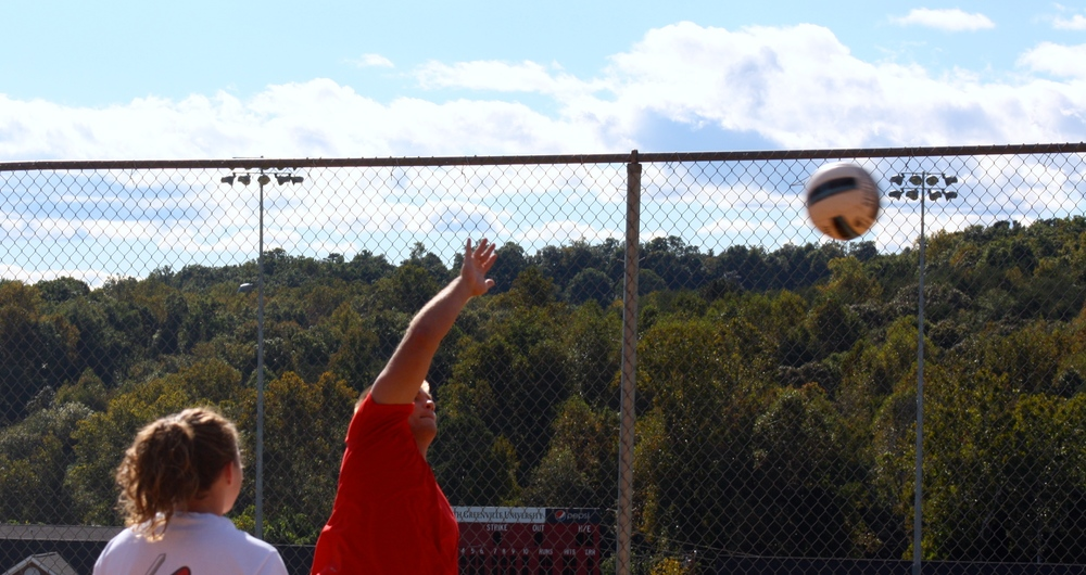 A students sends the ball flying.