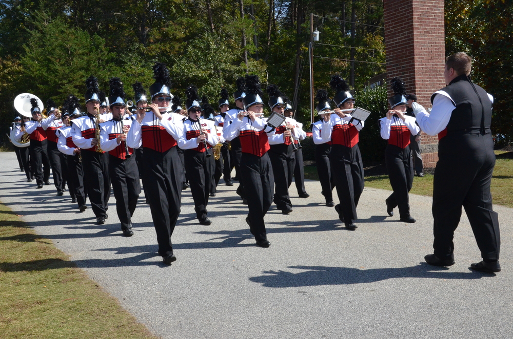 The North Greenville Marching Band starts off the 2014 Homecoming Parade on October 18 at North Greenville University by playing well-known contemporary music.