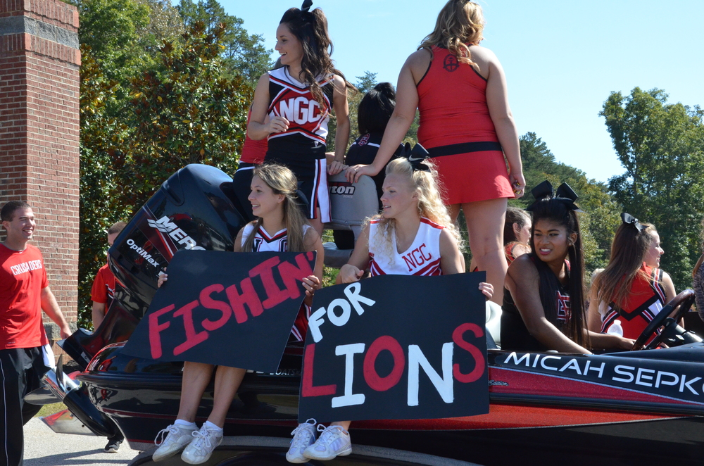 These cheerleaders will be fishing for some Lions during the big football game.