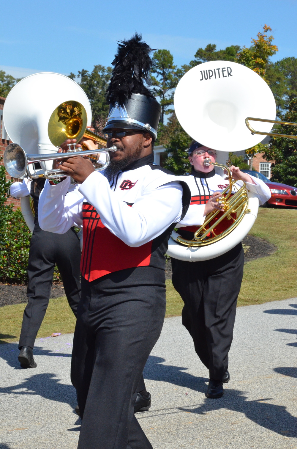 These band members are keeping their heads held high as they walk through the parade.