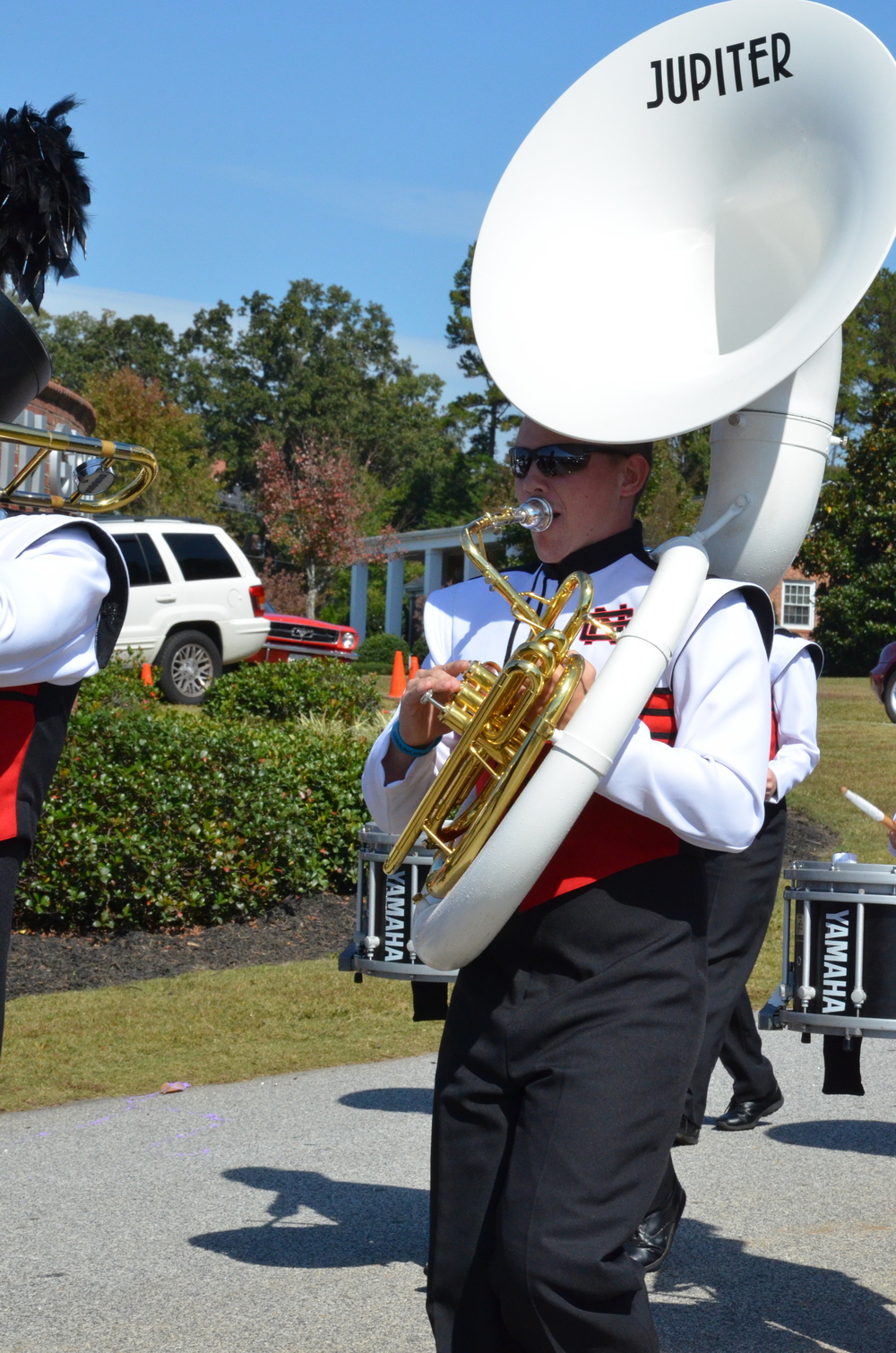 This tuba player is walking with pride, happy to represent NGU.