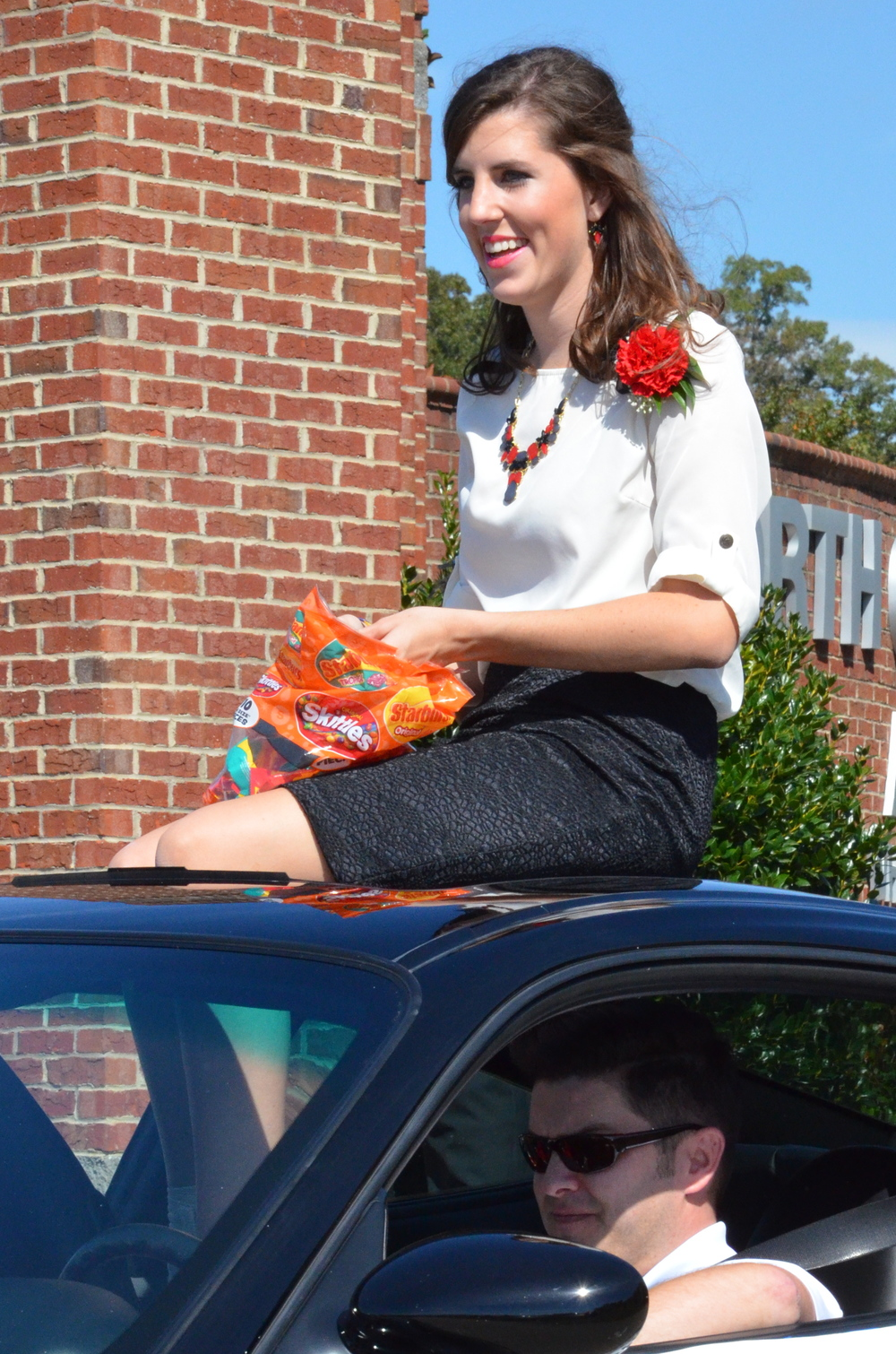 Kelsie Windsor is sitting tall and proud atop this beautiful car.