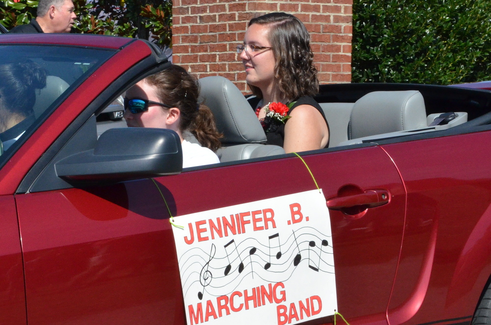 Jennifer Bramel sits happily in the Mustang as she represents the marching band.