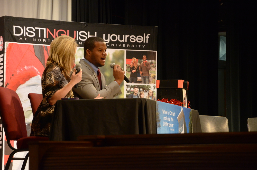 Justin Bishop and Katie Lynn Marshall, admissions counselors, start up the November 1, 2014 Encounter Day at North Greenville University by bringing up some current and past students and employees of NGU.