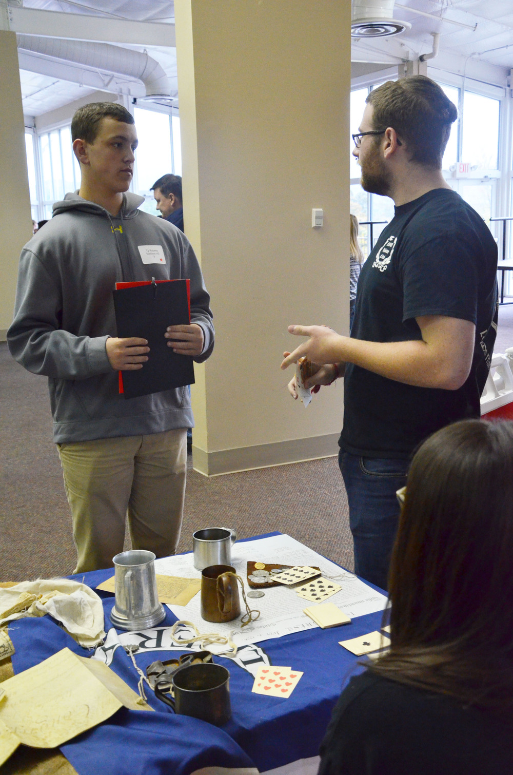 A North Greenville student is talking to a guest about the History Department on campus.