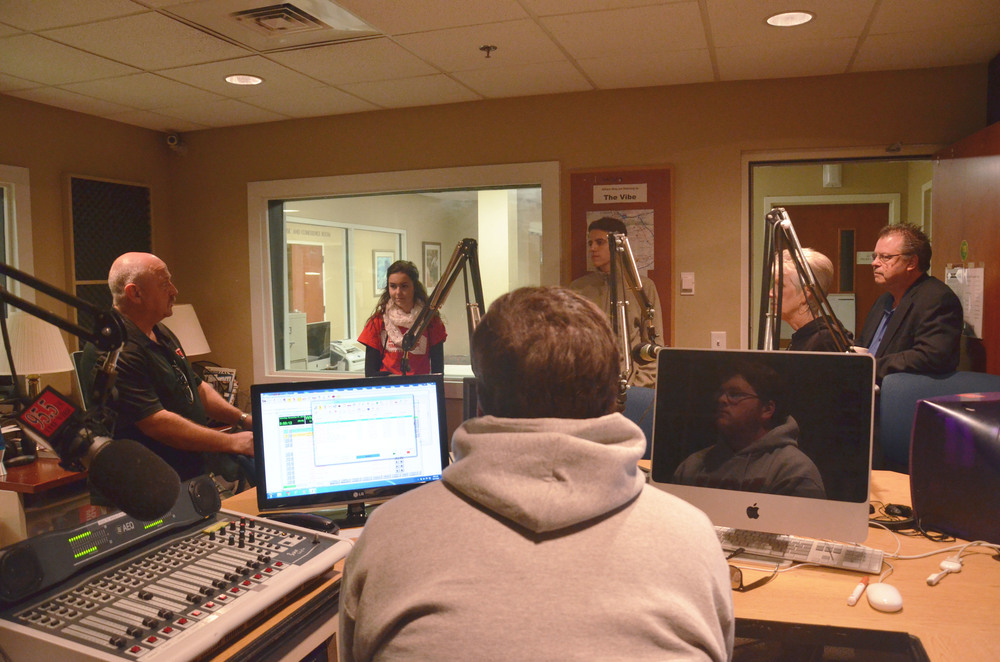 Mr. Stevens, a Mass Comm. Instructor, is informing these guests about the radio program in the Mass Comm. Department.