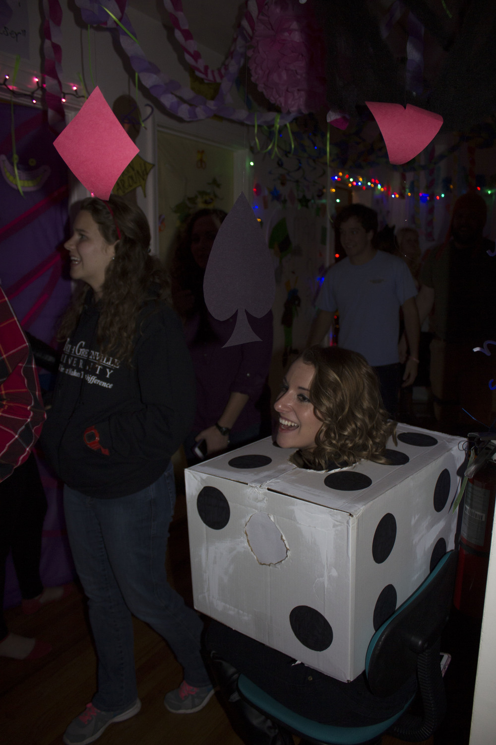 Sophomore Marianne Woodard laughs as she enjoys the different scenes and characters the girls in Chinquapin 8 dressed up as.