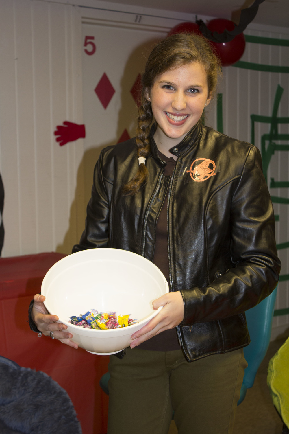 Freshman Megan Darcy offers candy to all those who pass by.