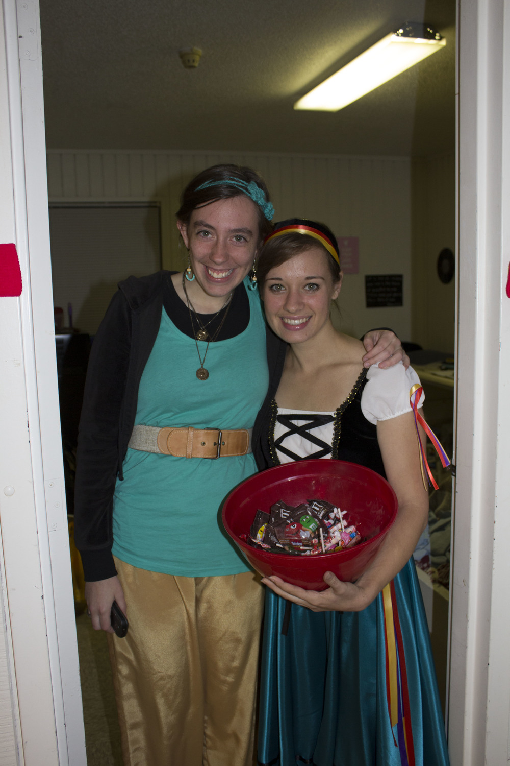 Juniors MaryEllen Lovin and Gabbi Miller show off their costumes while handing out candy to the kids that stop by.
