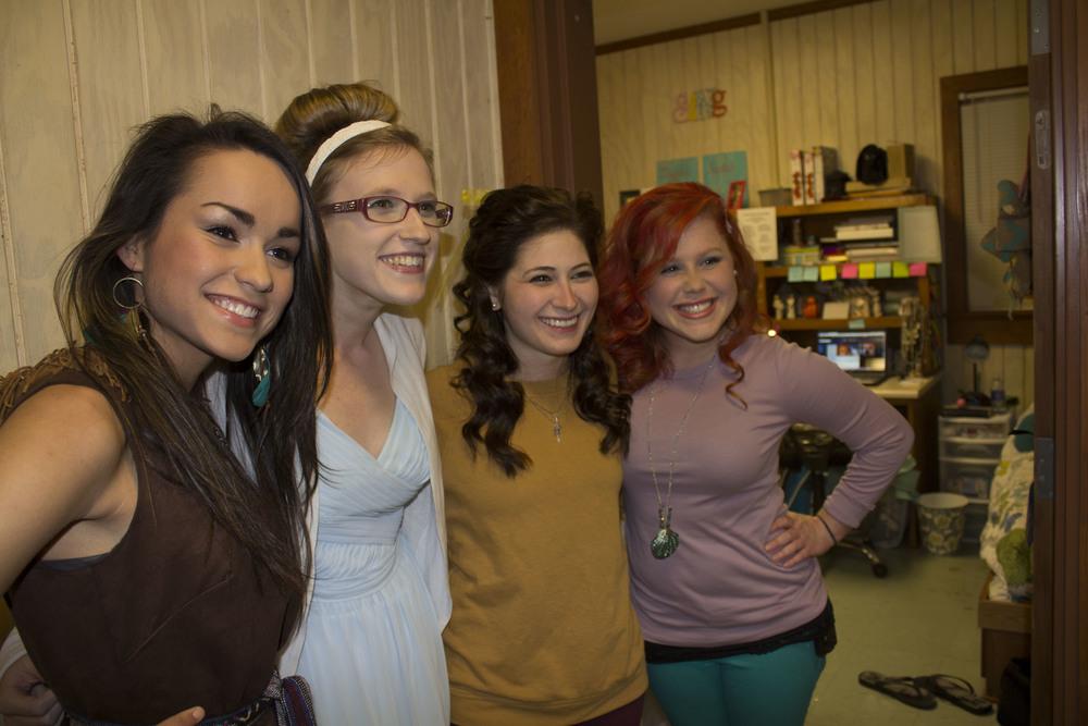 Sophomore Melanie Rice, junior Corinn David, sophomore Annie Edwards and senior Molly Williamson all dress up as beautiful Disney princesses.