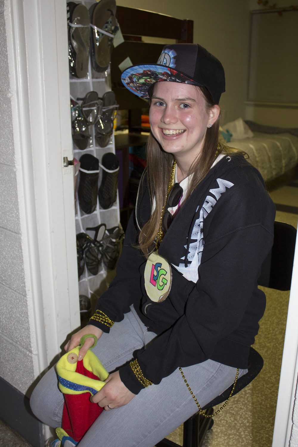 Sophomore Sarah Garrett, dressed as a gangster, holds her stocking full of candy to hand out to children passing by.