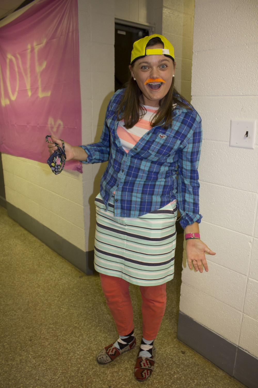 Sophomore Anne Hayden Huxford strikes a silly pose in her wacky Halloween costume.