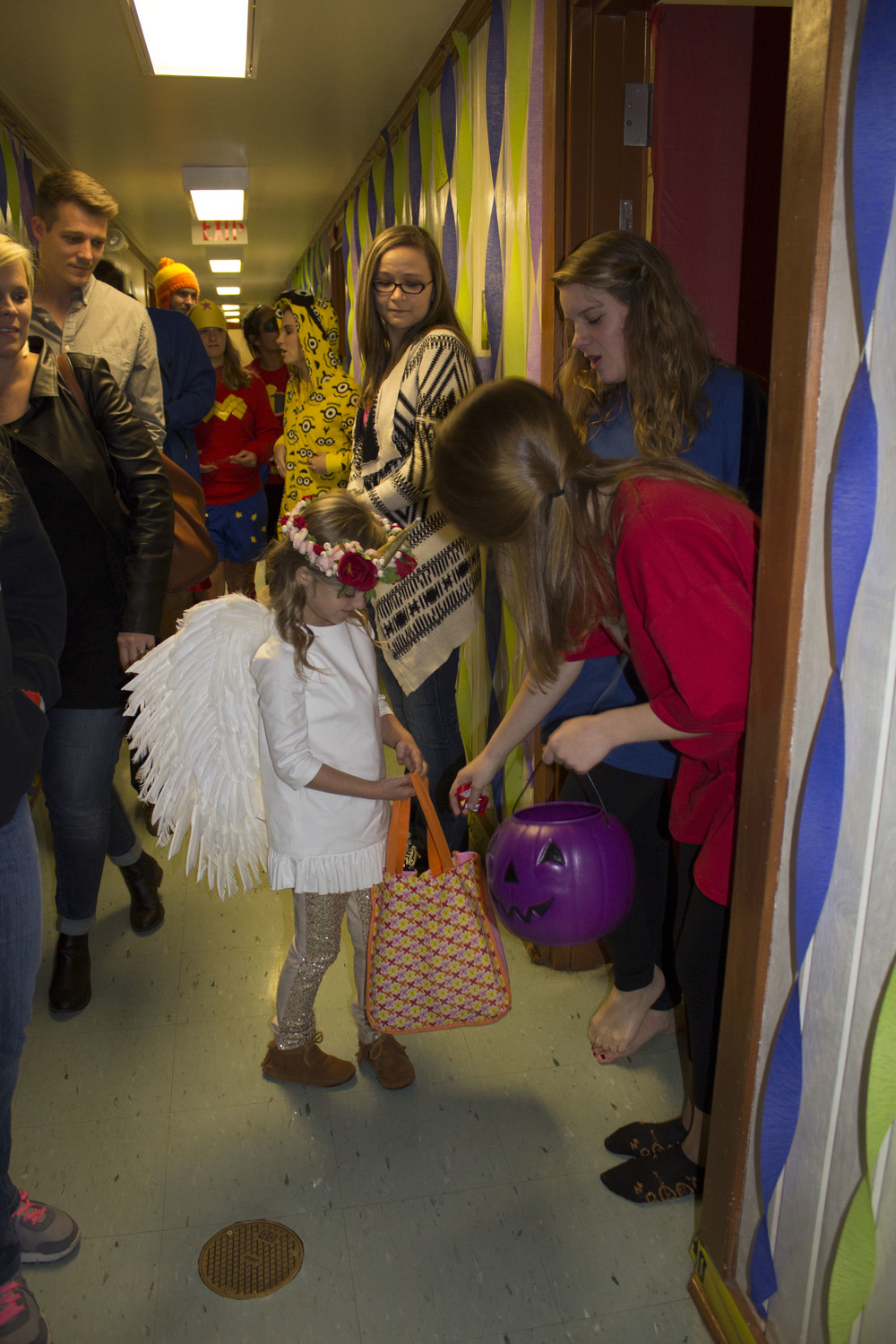 Sophomores Sarah Wells and Amy Coleman hand out candy to the kids passing down their hall.
