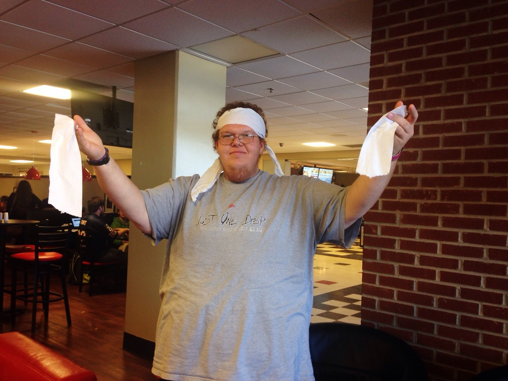 TomTom Grindell indulges himself in some festive toilet paper attire.