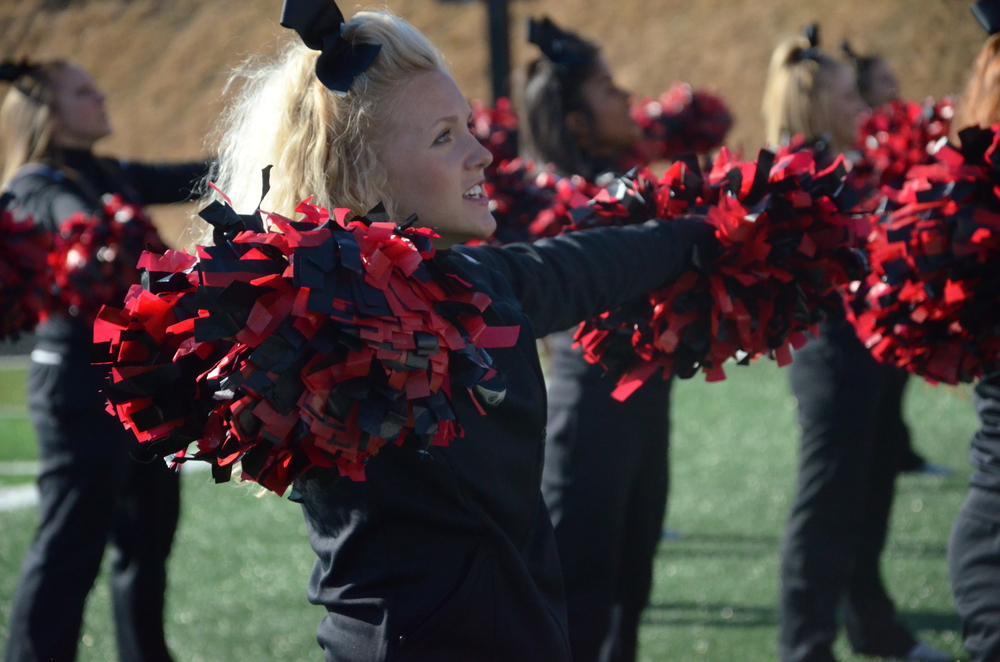An NGU cheerleader is happy to help the crowd root for the Crusaders.