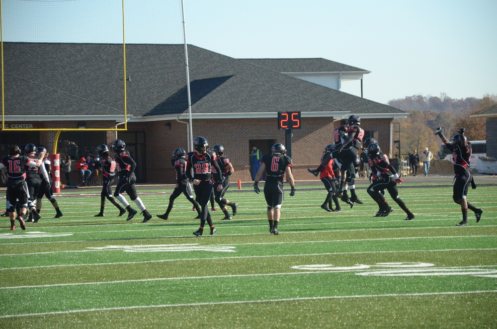 Some excited Crusaders make an exclamatory jump after a successful touchdown.