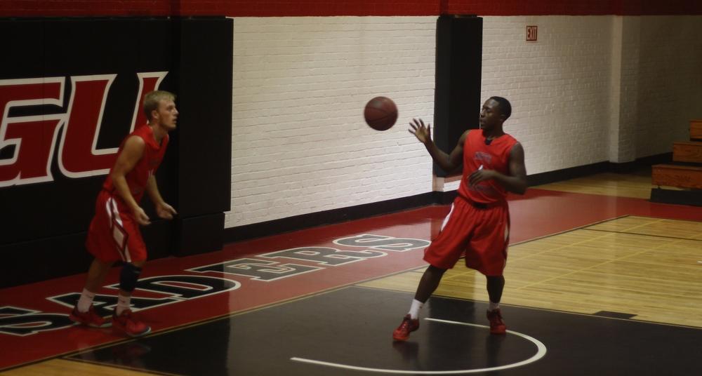 #14 Treis Huggins puts the ball into play.