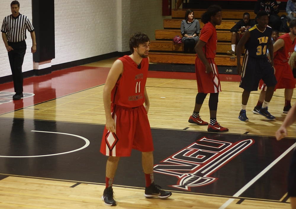 #11 Garrett King prepares for his team to make it back down the court.